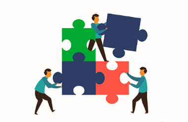 Cooperación creando puzzle